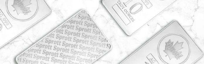 Top down view of four silver bars