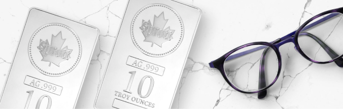 Two silver bars next to a pair of glasses