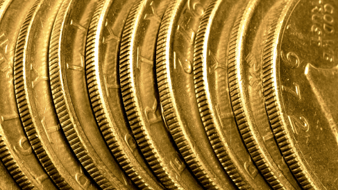 A zoomed in view of multiple gold coins